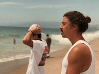 two man near seashore
