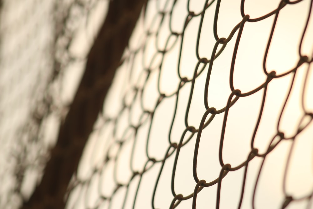 shallow focus photo of cyclone fence