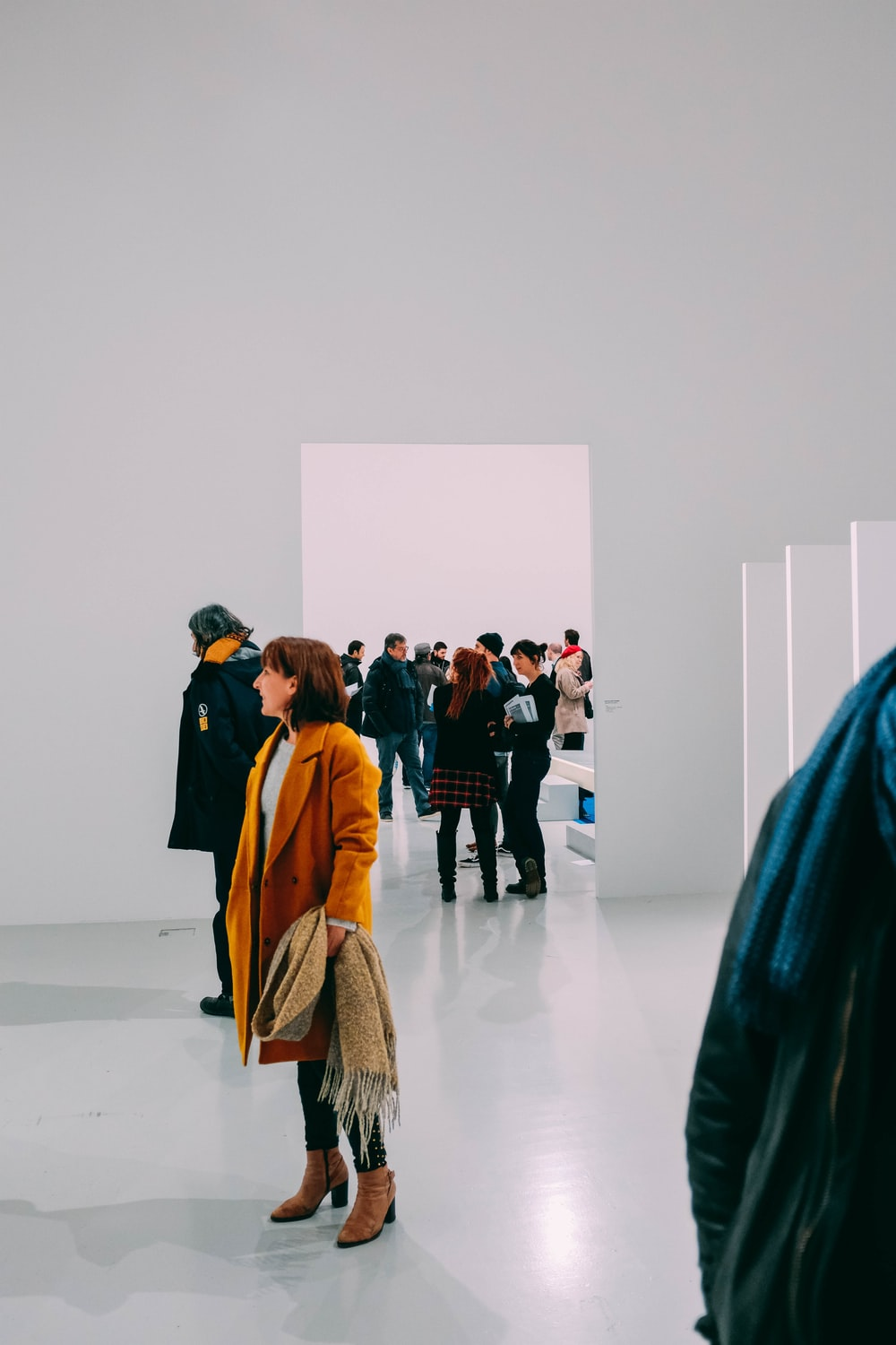 woman standing in side white room