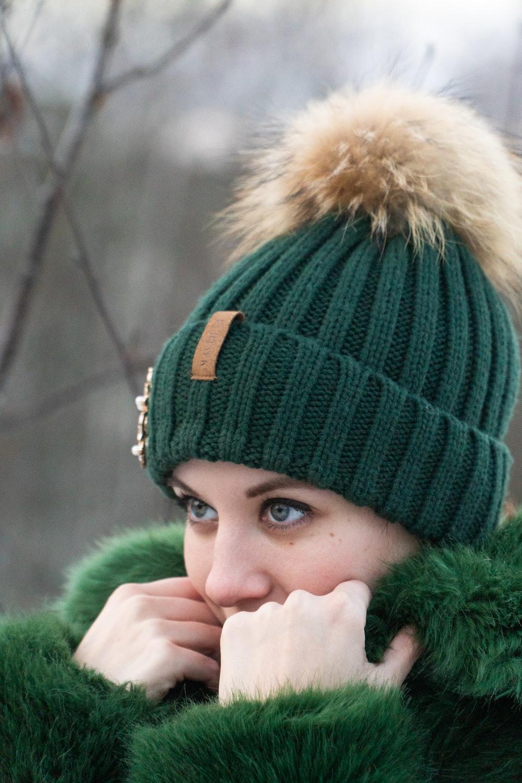 woman wearing bobble hat