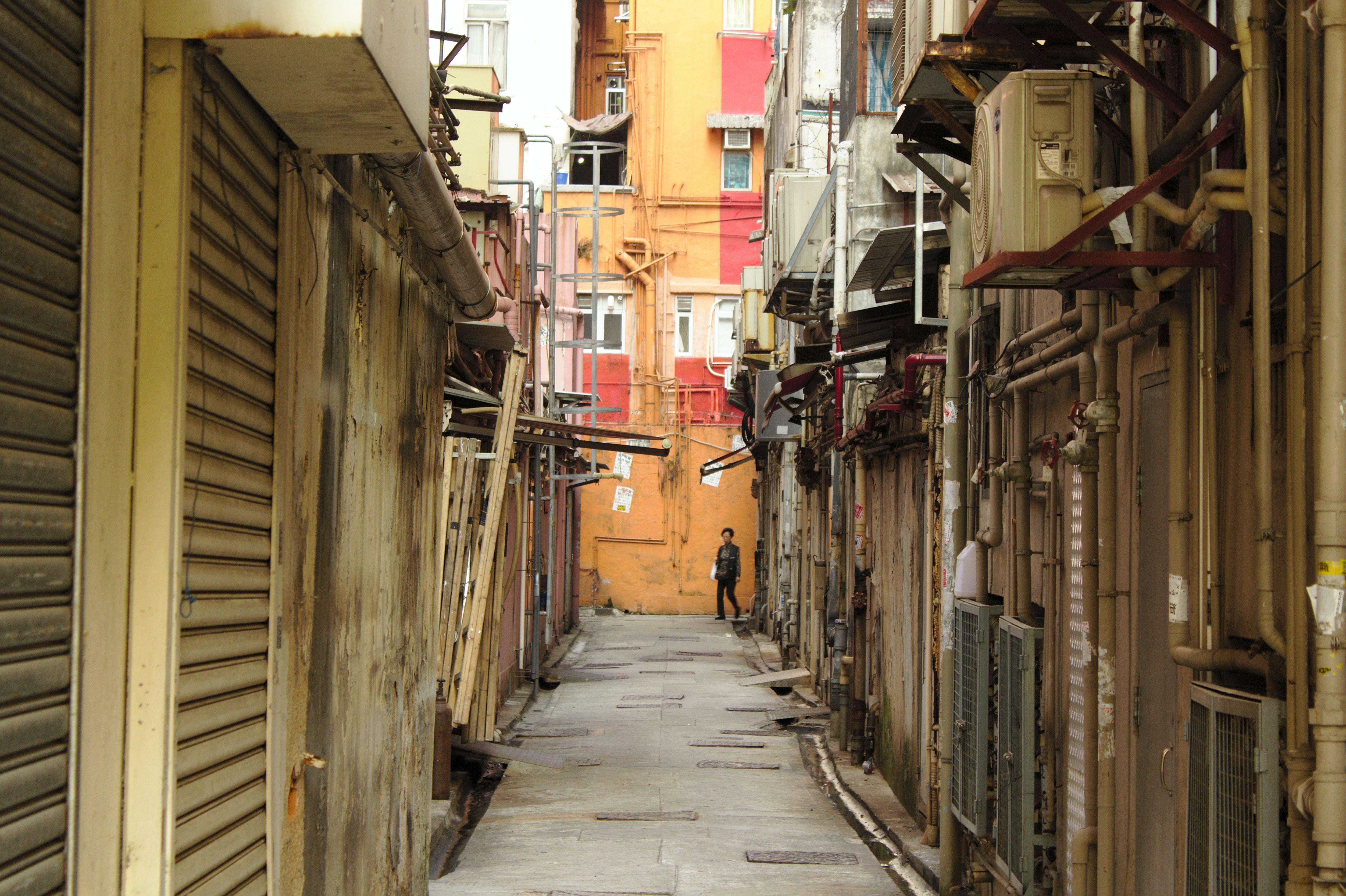 boy standing in alley