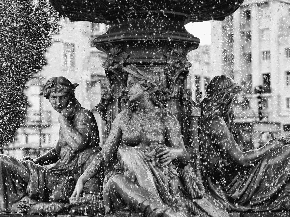 grayscale photography statue of women