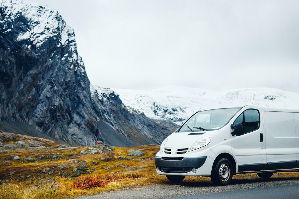 white van parked near mountain