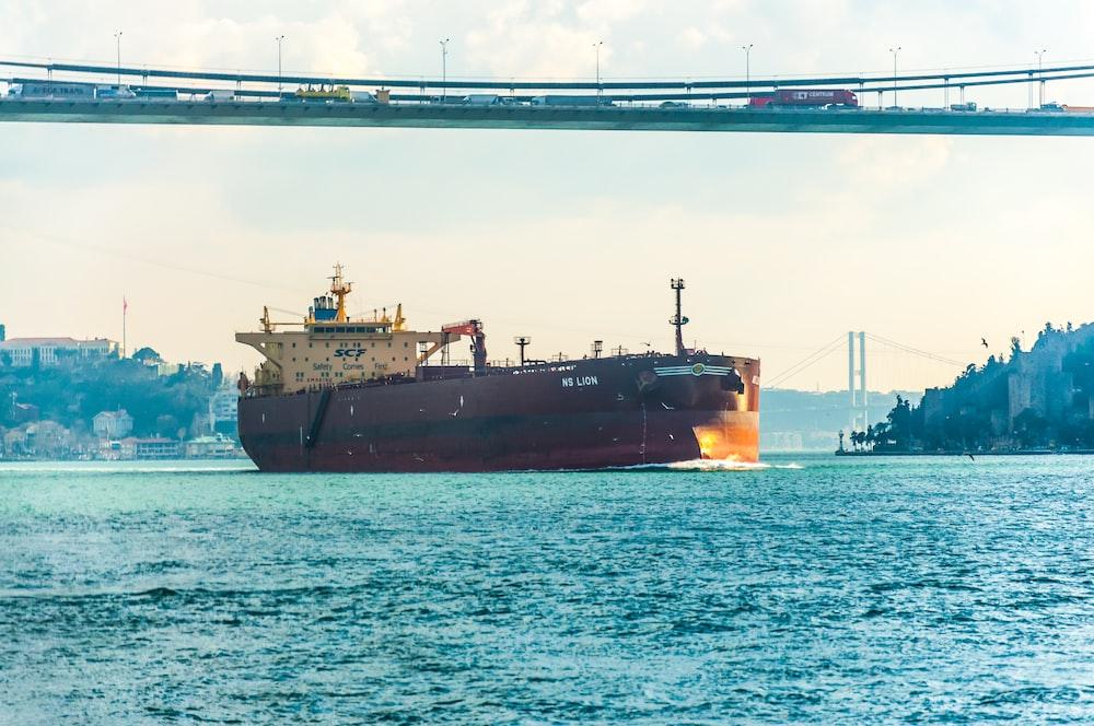 maroon ship on sea