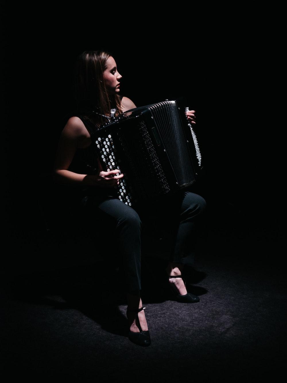 woman playing accordion