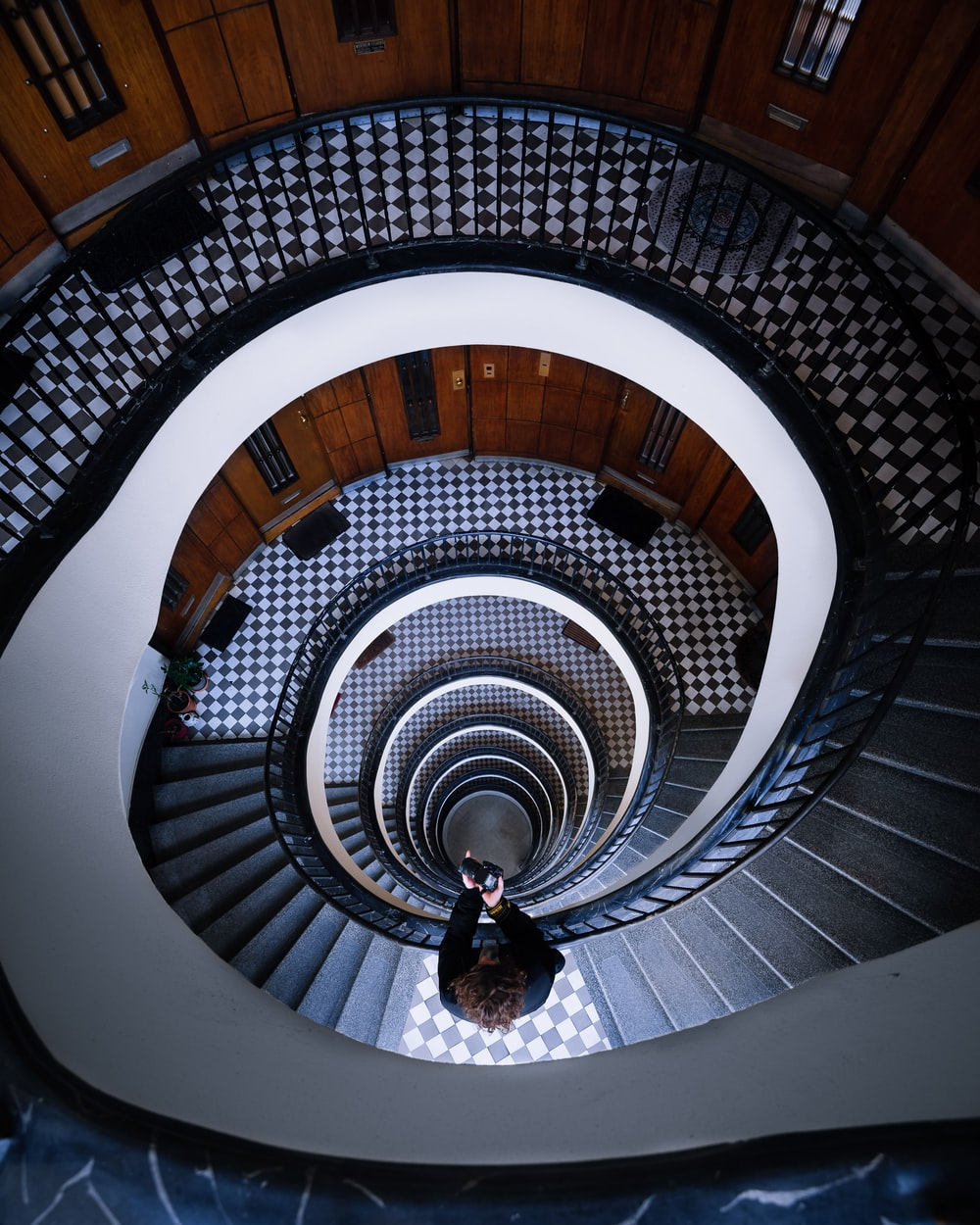 high angle photography of spiral stairs