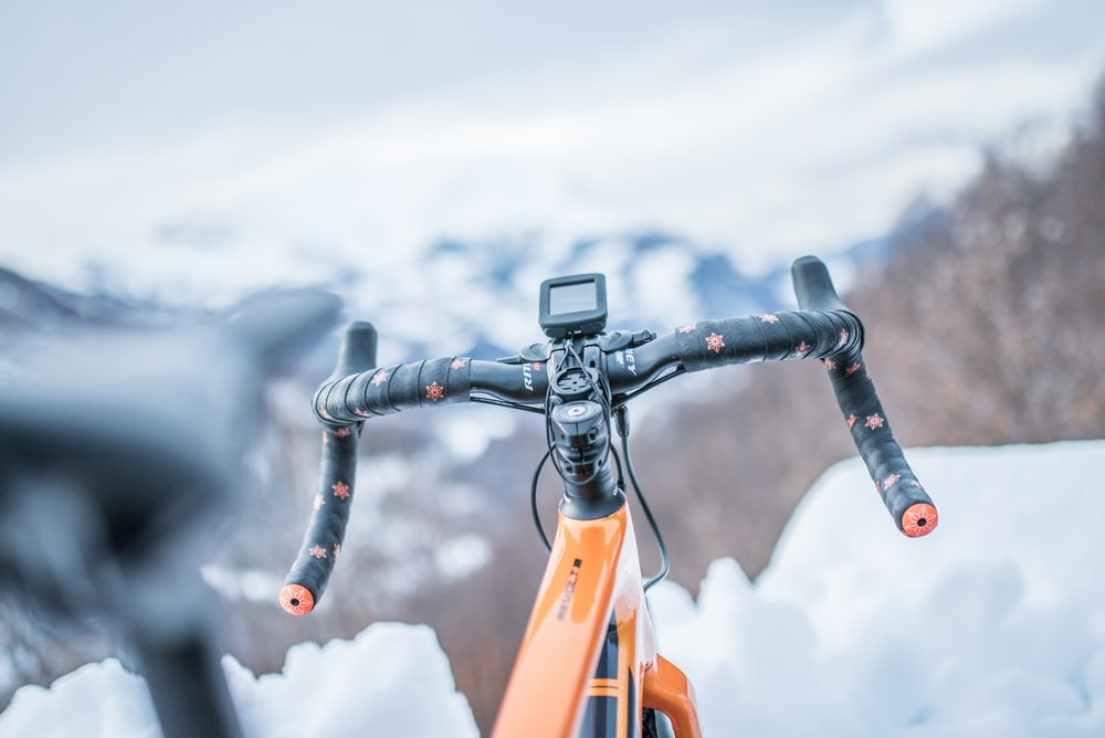 orange road bike on selective focus photography