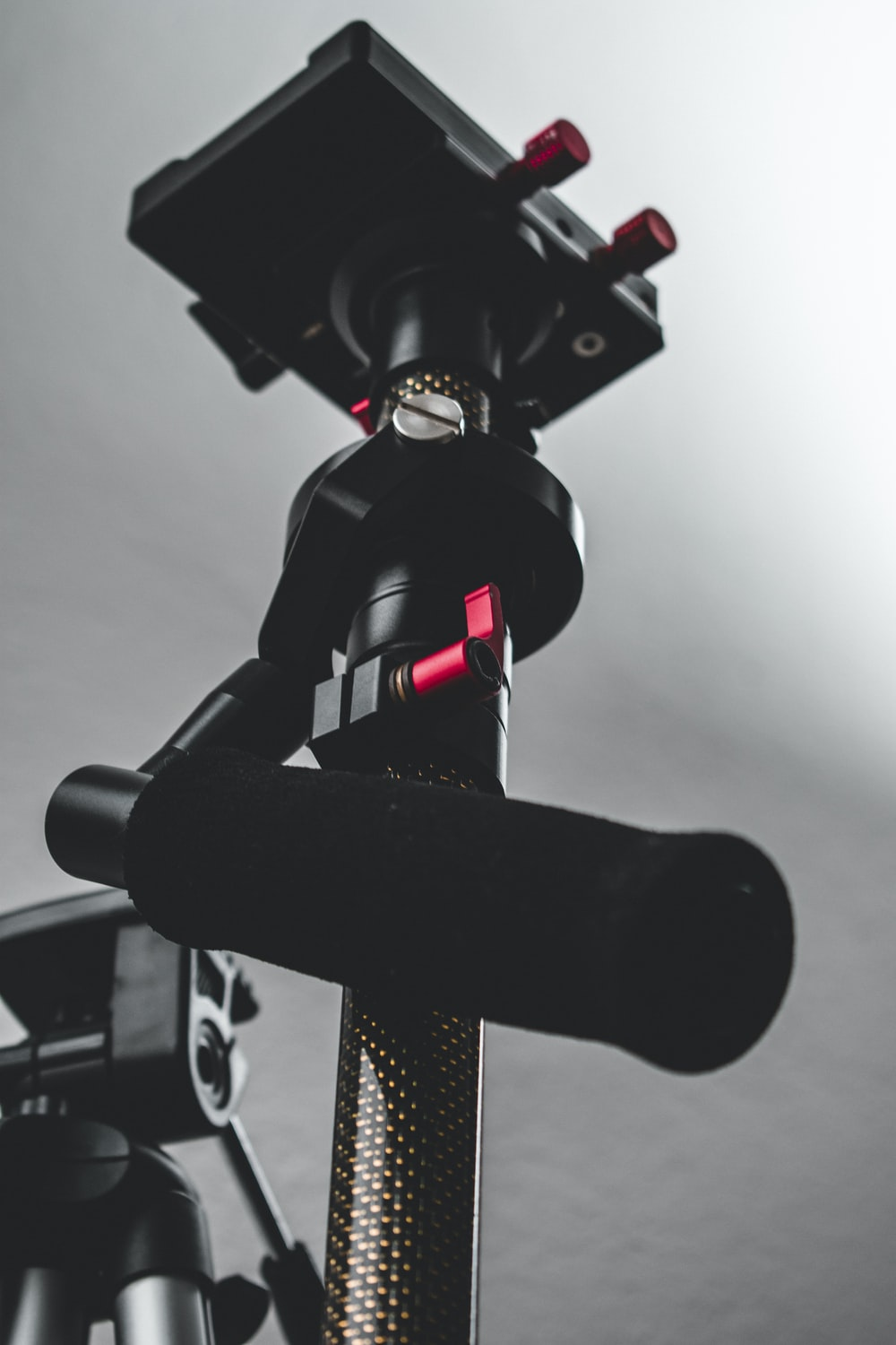 close-up photography of black camera stand