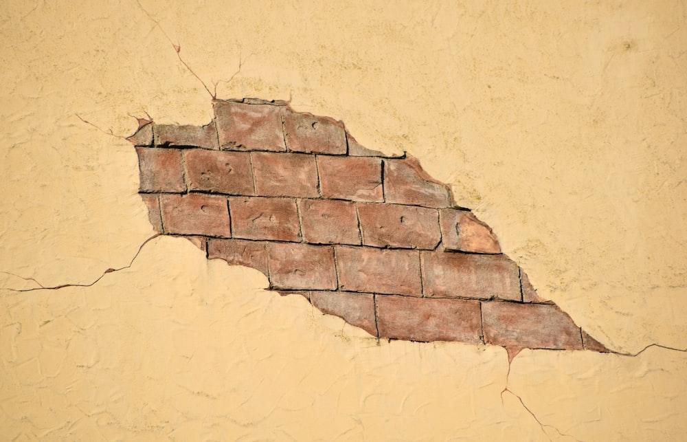 broken beige wall