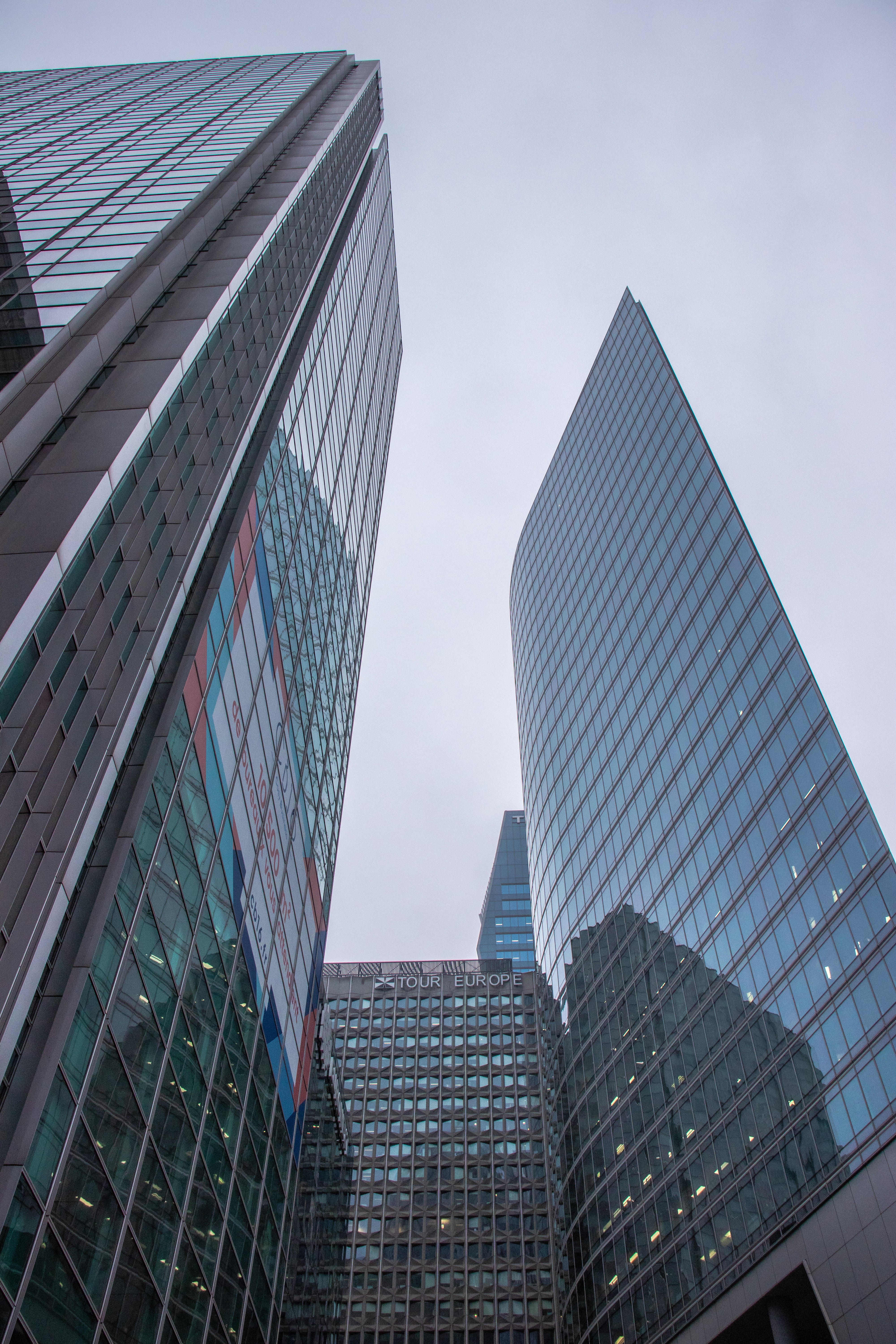 curtain wall buildings under white sky
