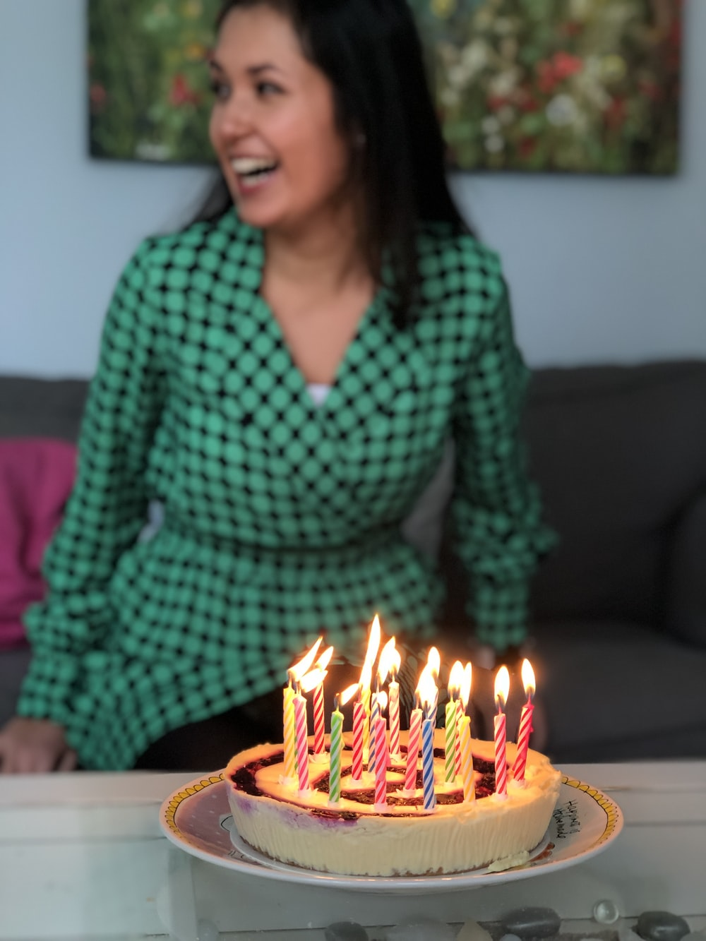 smiling woman in front of cake