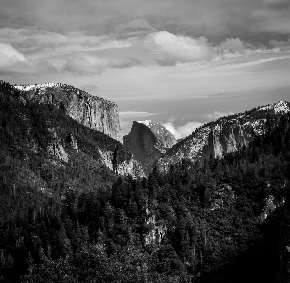 grayscale photo of snow covered mountains