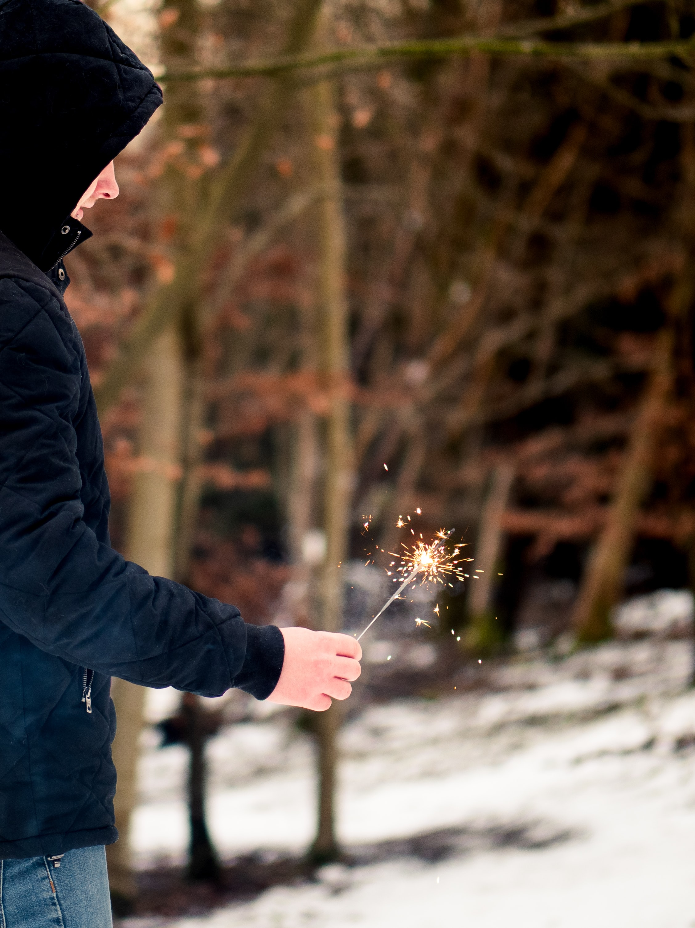person holding sparkler stick