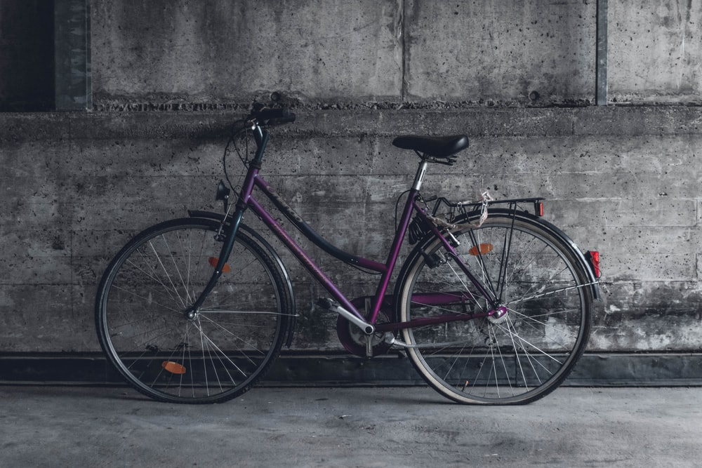 purple and black beach cruiser bicycle