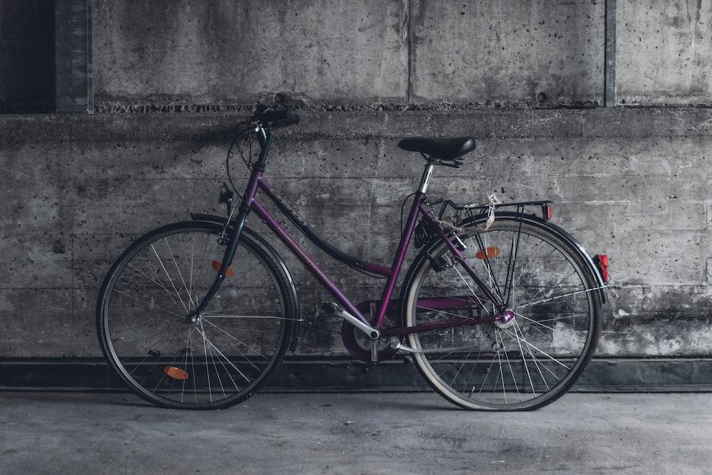 purple and black beach cruiser bicycle
