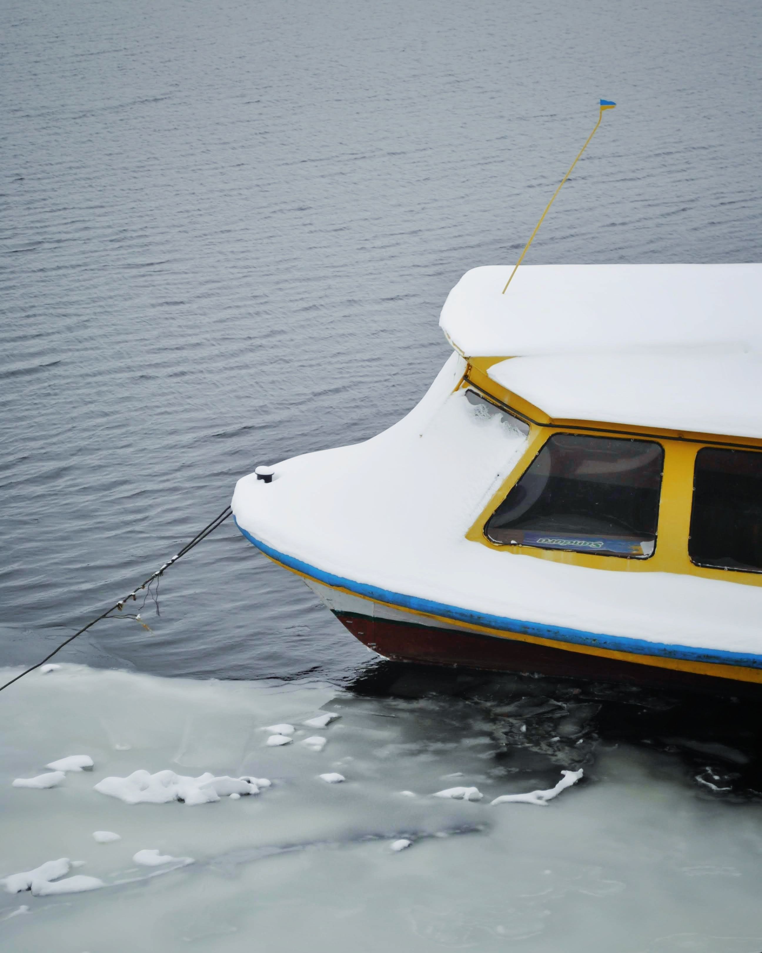 white and yellow boat