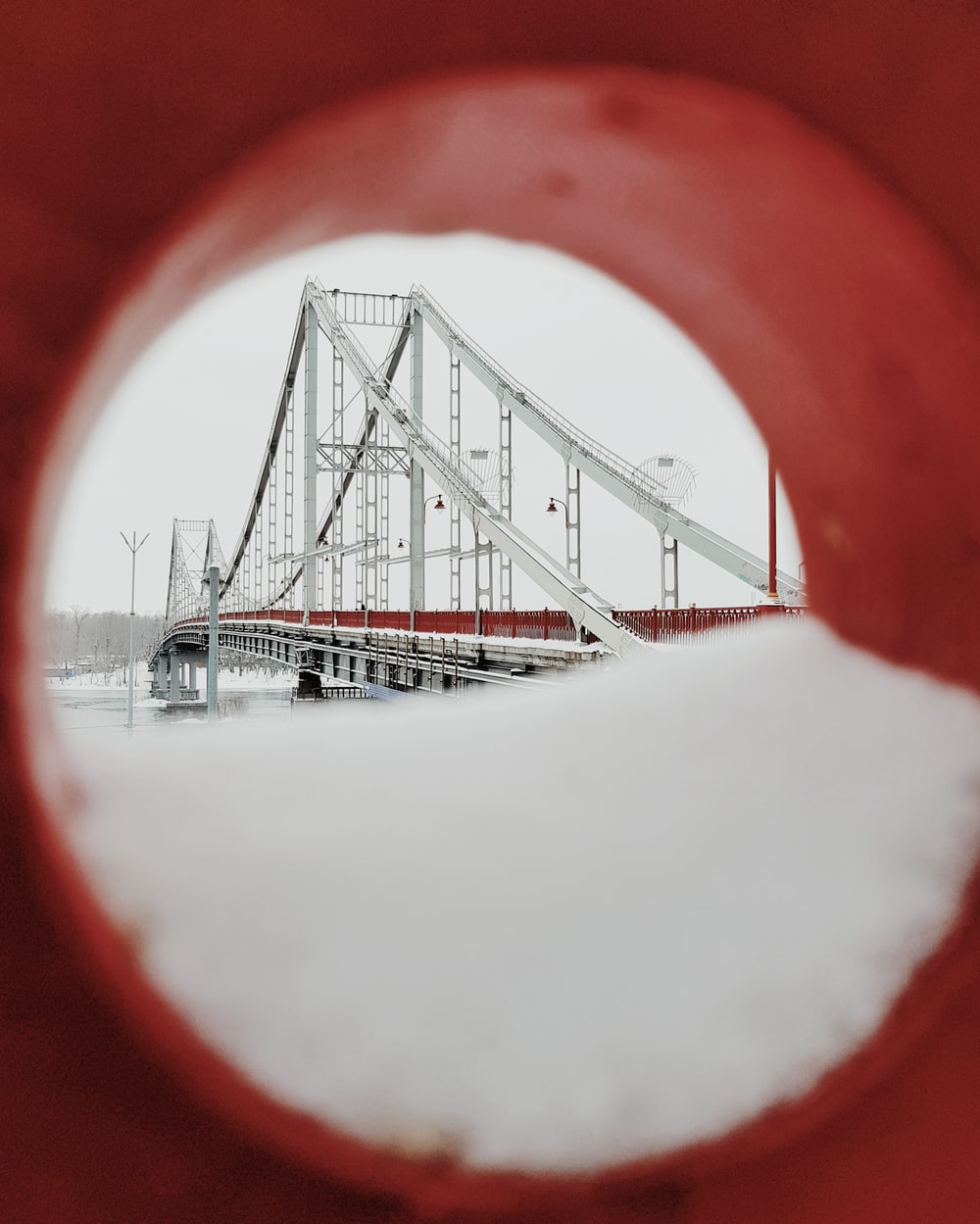 force photography of white and red bridge under white sky