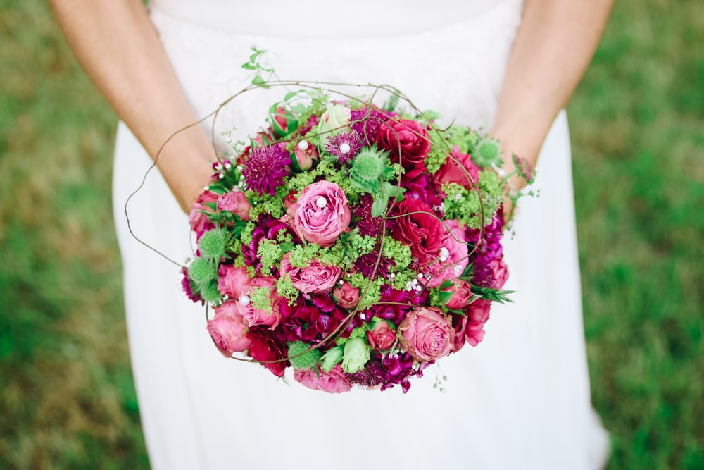 pink and purple petaled flowers bouquet