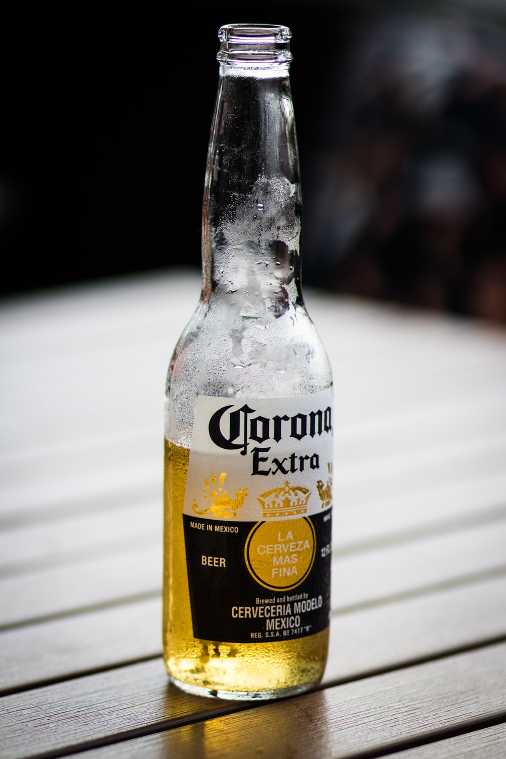 half-filled Corona Extra glass bottle