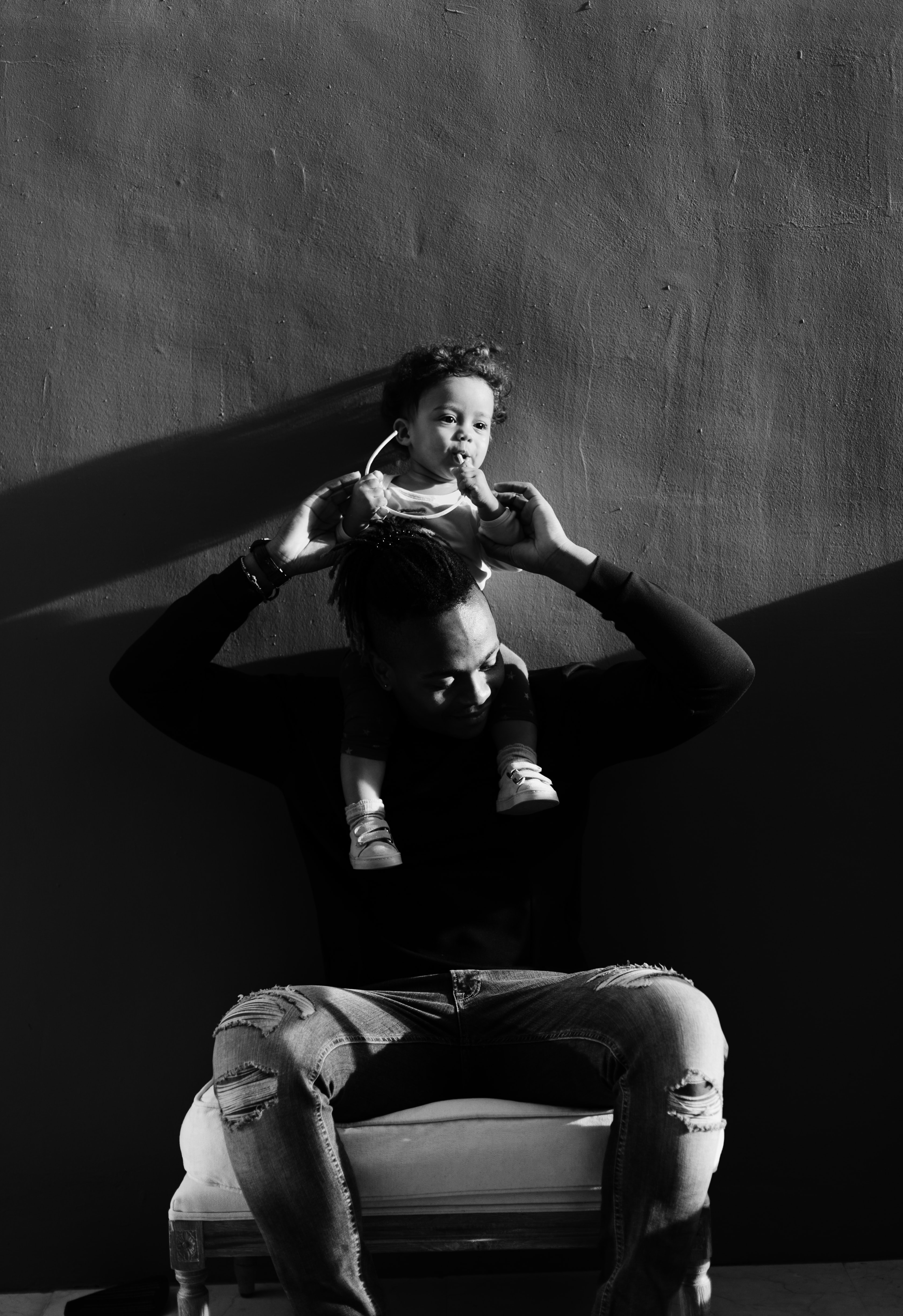 grayscale photography of man lifting a girl