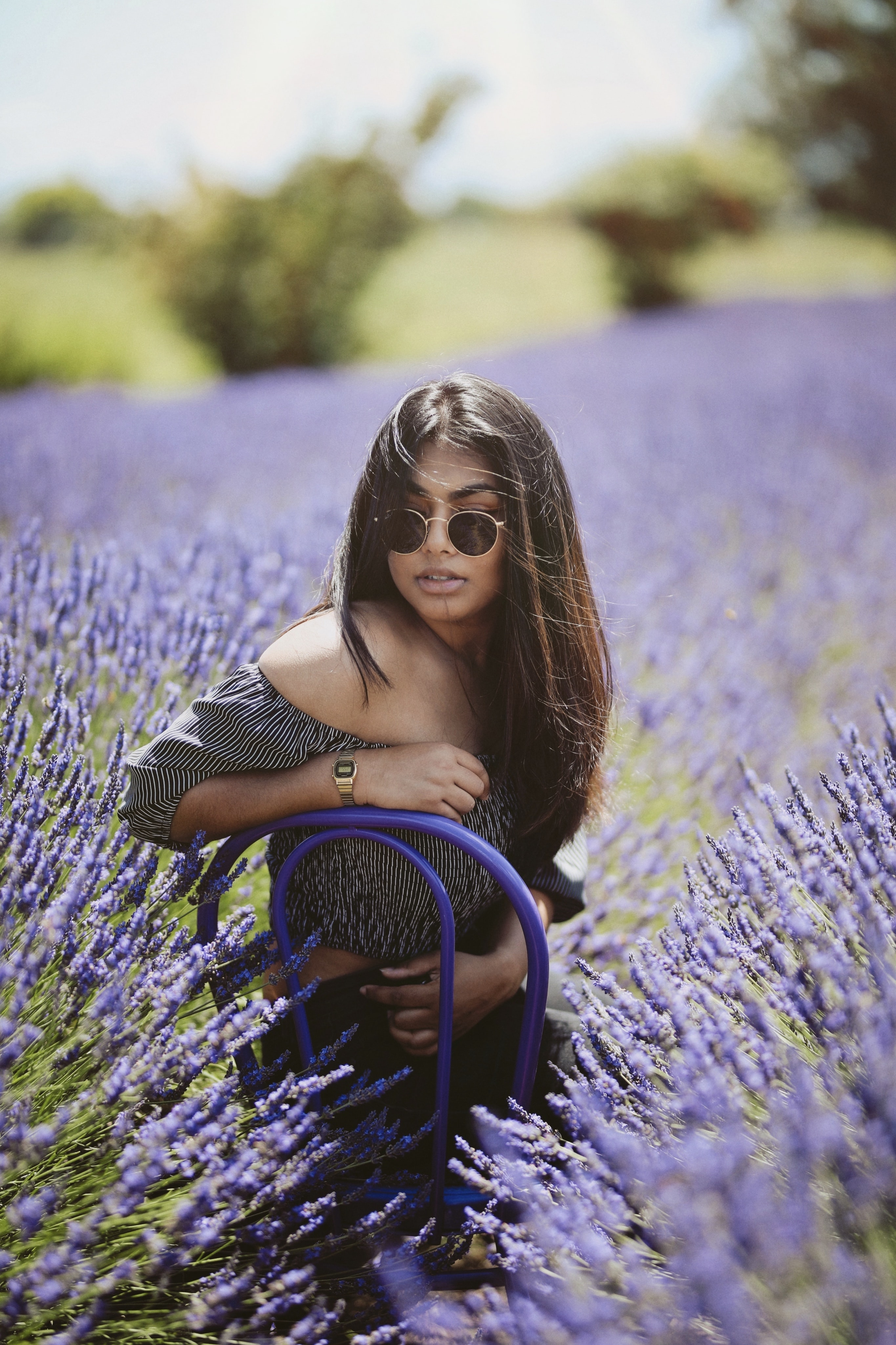woman in the middle of the lilac flower field