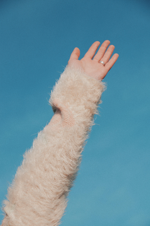 person wearing beige fur long-sleeved shirt