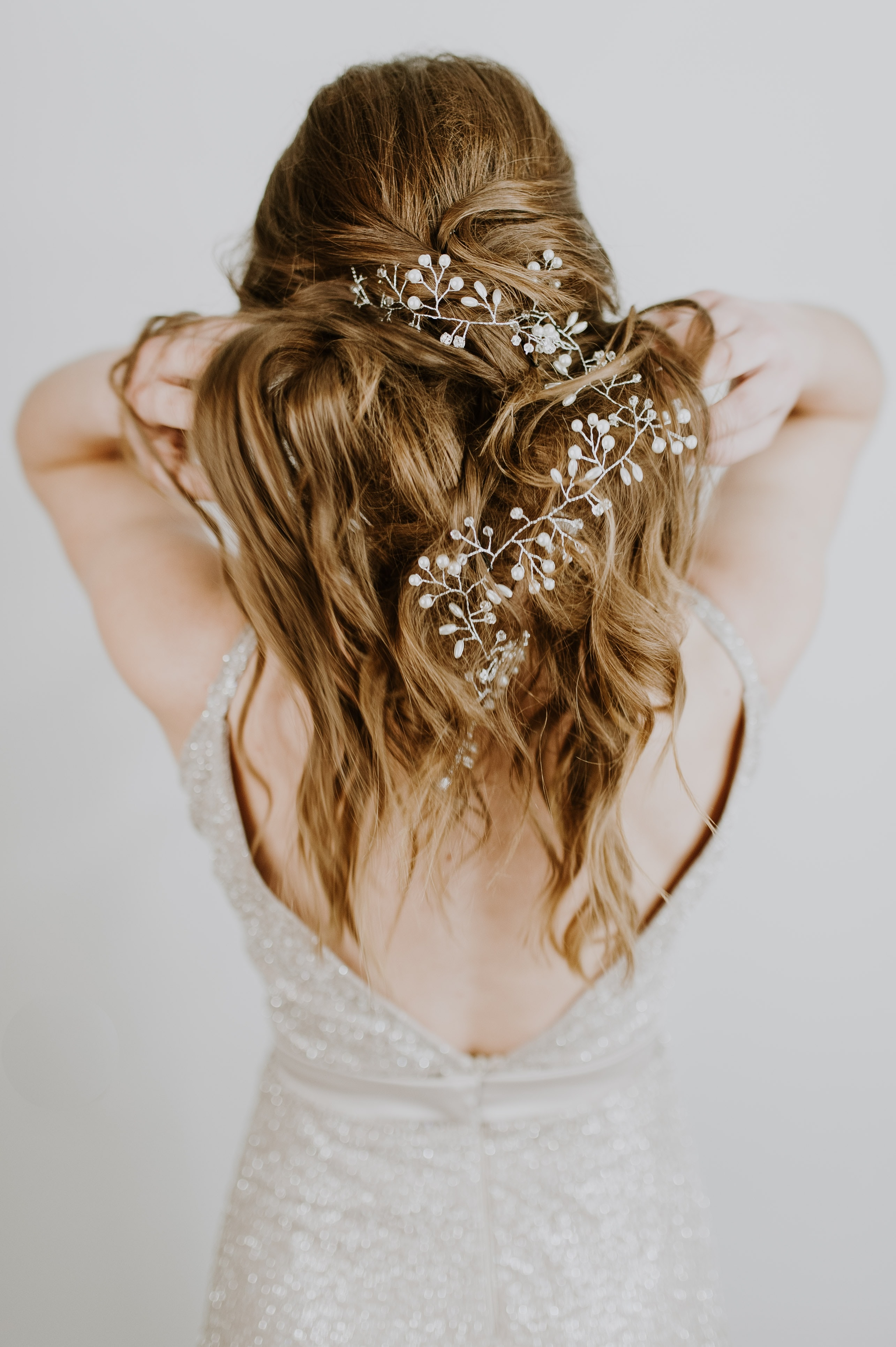 woman standing and touching hair