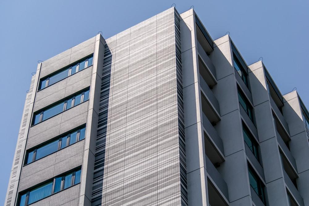 white concrete high-rise building under blue sky