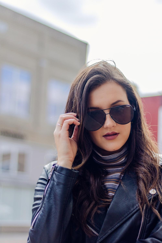 woman holding sunglasses