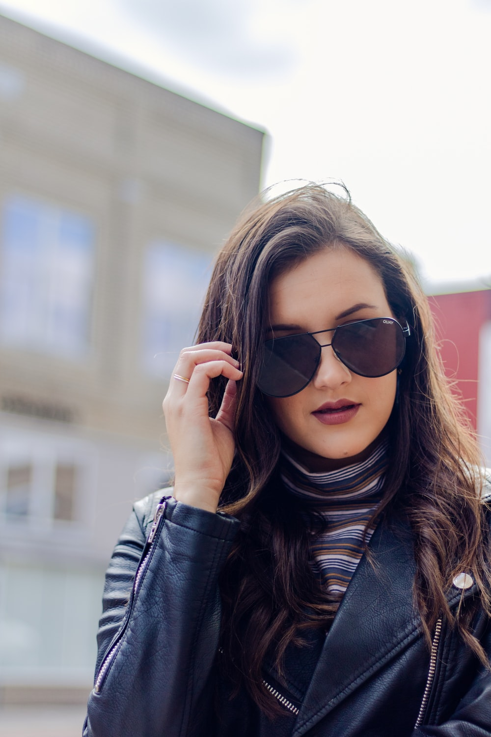 woman holding sunglasses