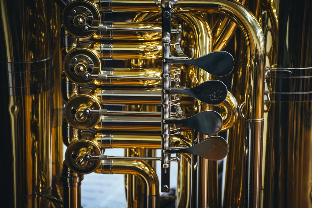 close-up photography of brass-colored wind instrument