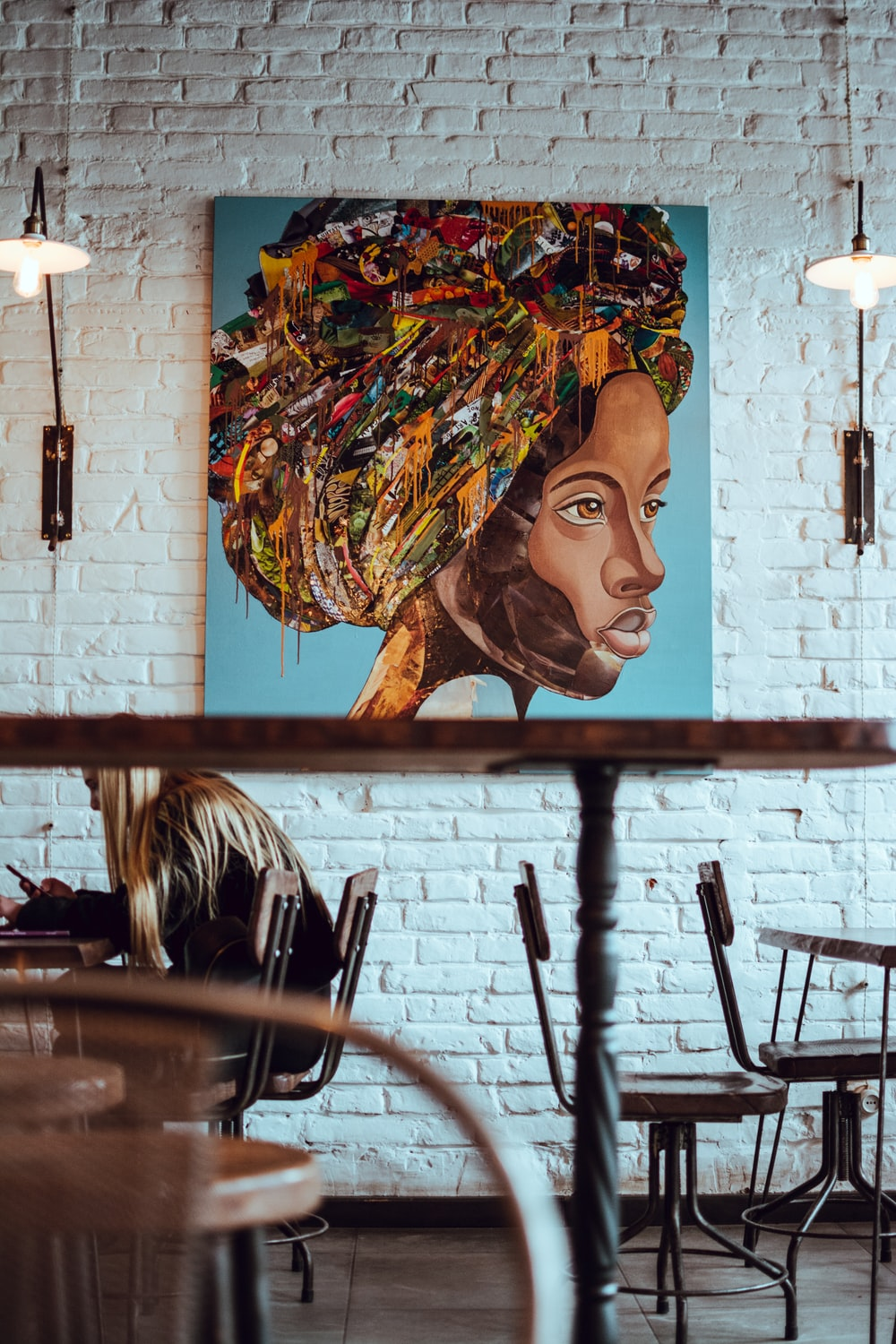 multicolored painting of woman's portrait hanging on wall