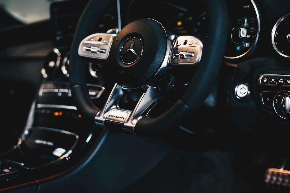 black Mercedes-Benz steering wheel