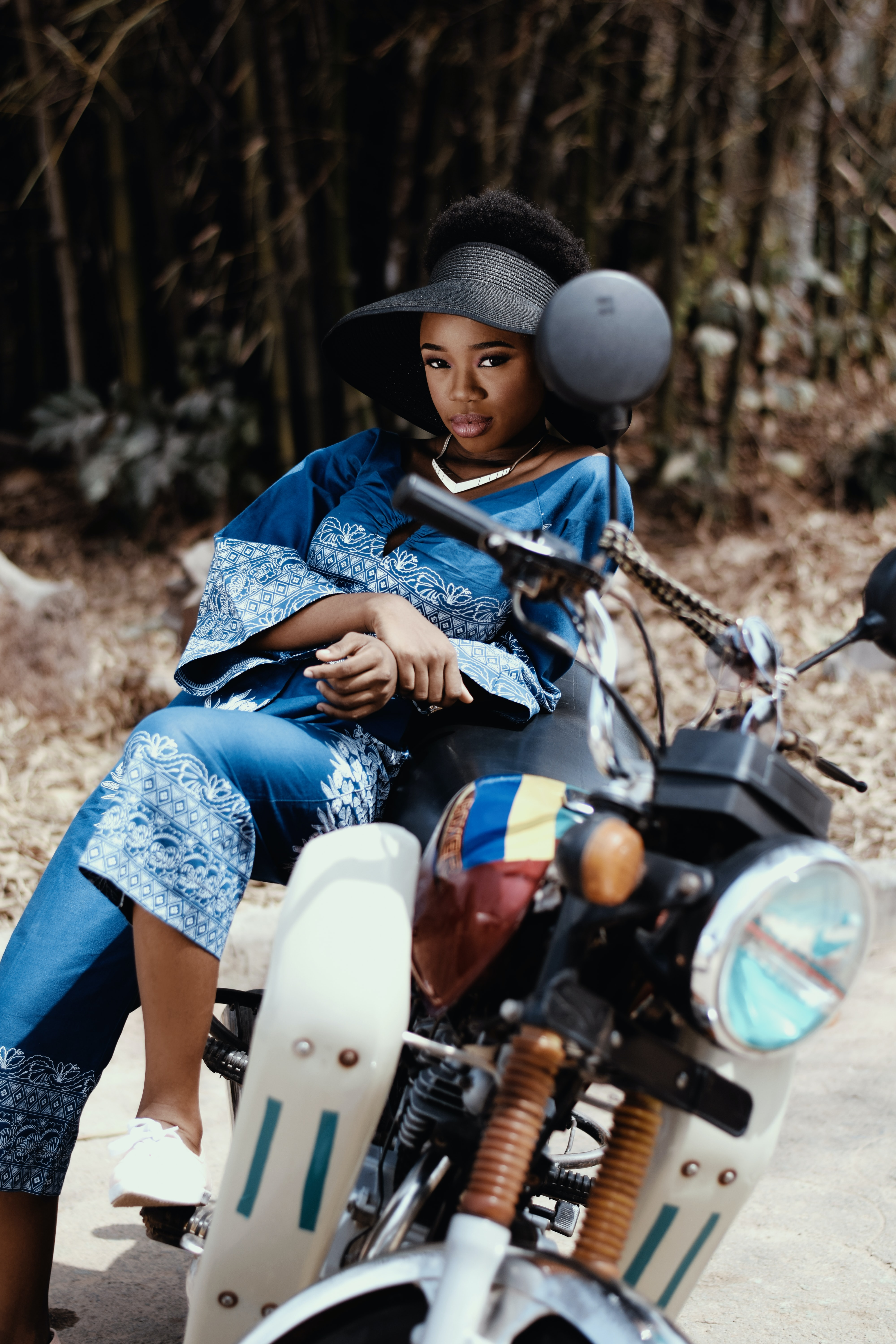 woman resting on motorcycle outdoor