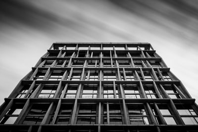 grayscale photography of concrete building noir zoom background