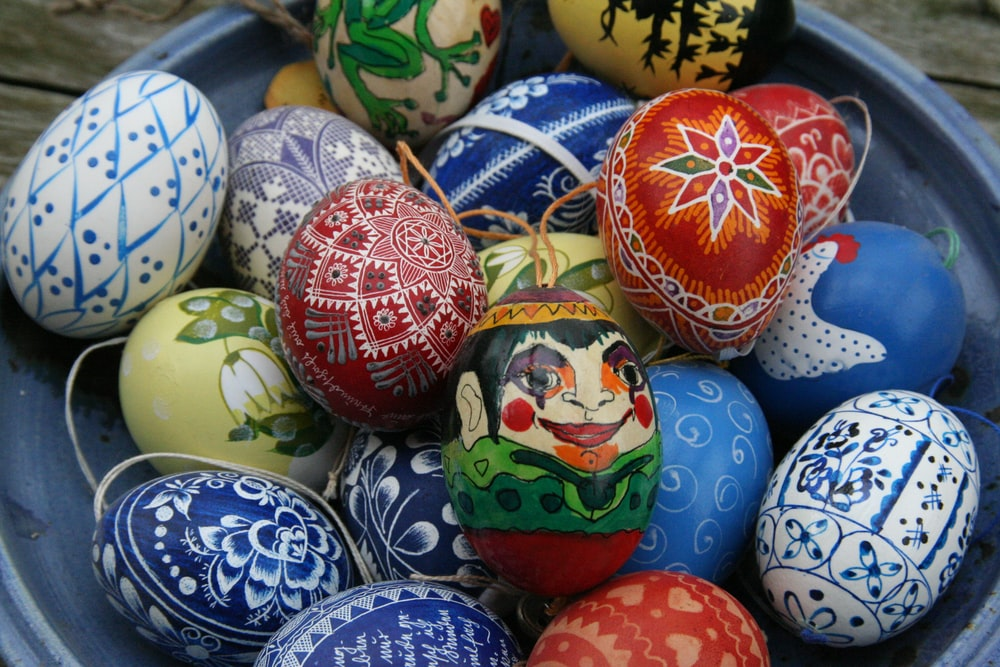 assorted-color Easter eggs on bowl