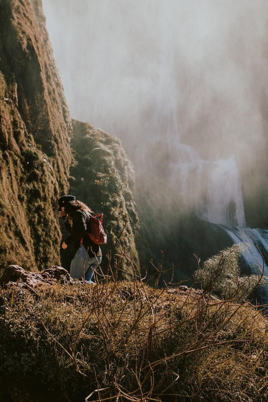 woman standing near mountain peak