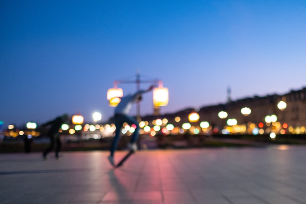 two man playing skateboard at night
