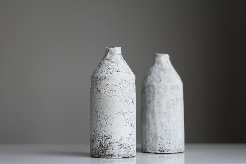 two grey bottles on surface