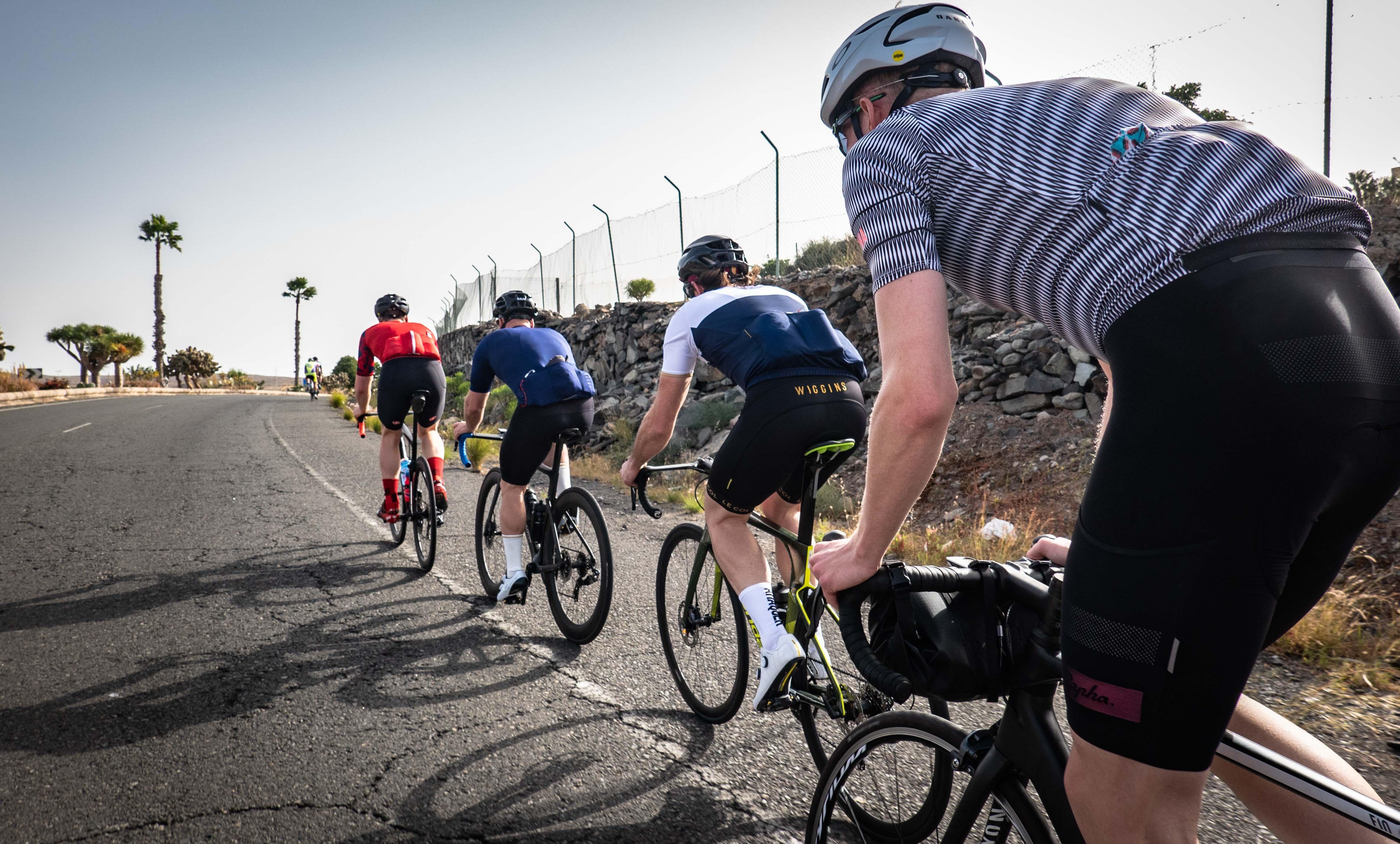 four man riding bicycle on road during daytime