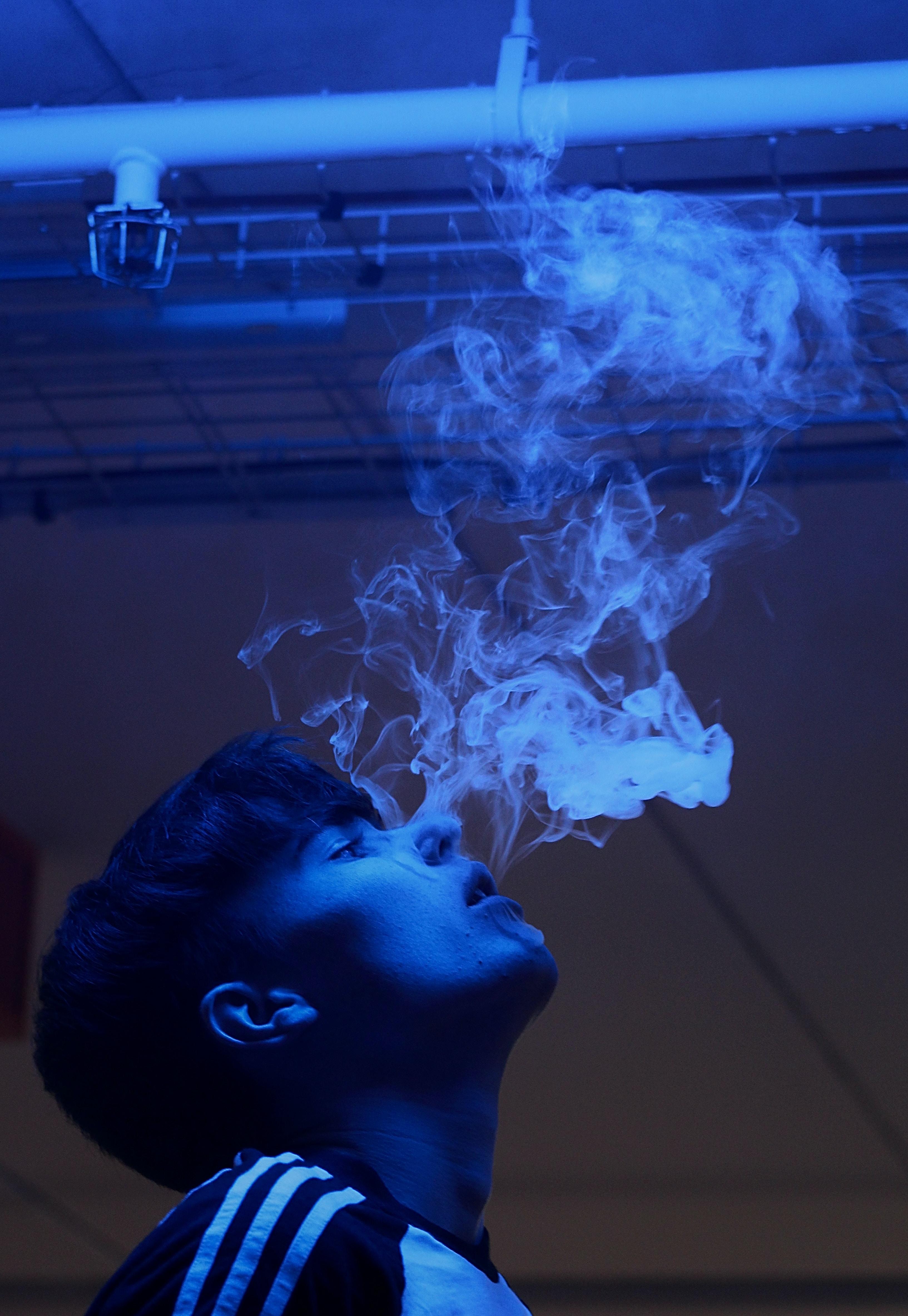 close-up photography of man smoking