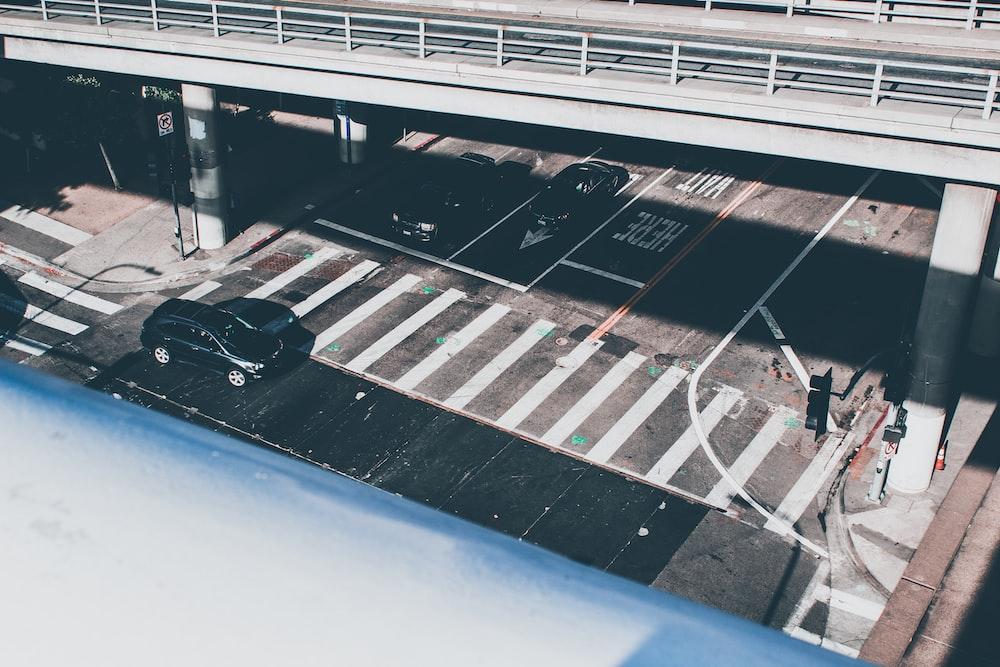 black vehicle parked near pedestrian lane