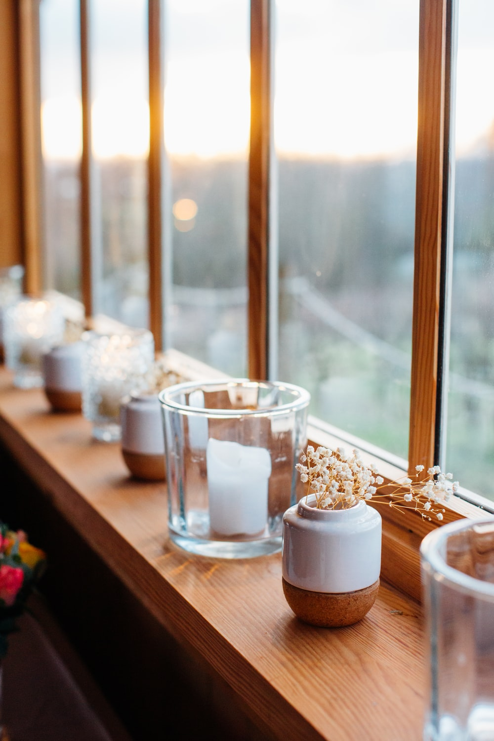 selective focus photography of clear glass pillar candle holder