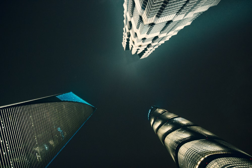 three low-angle photography of buildings
