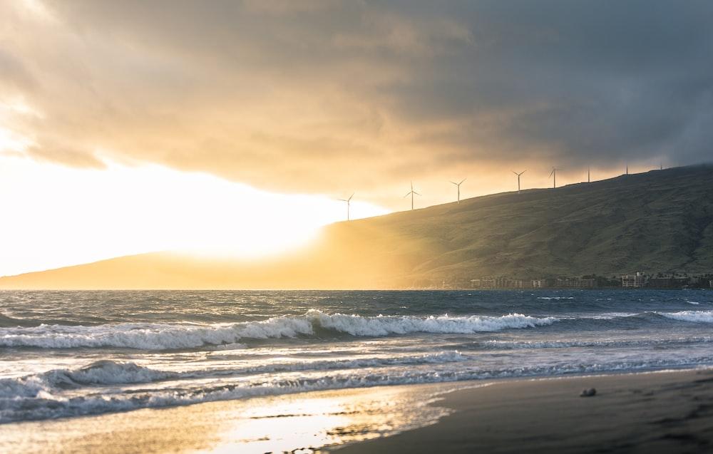 short waves of ocean water during golden hour