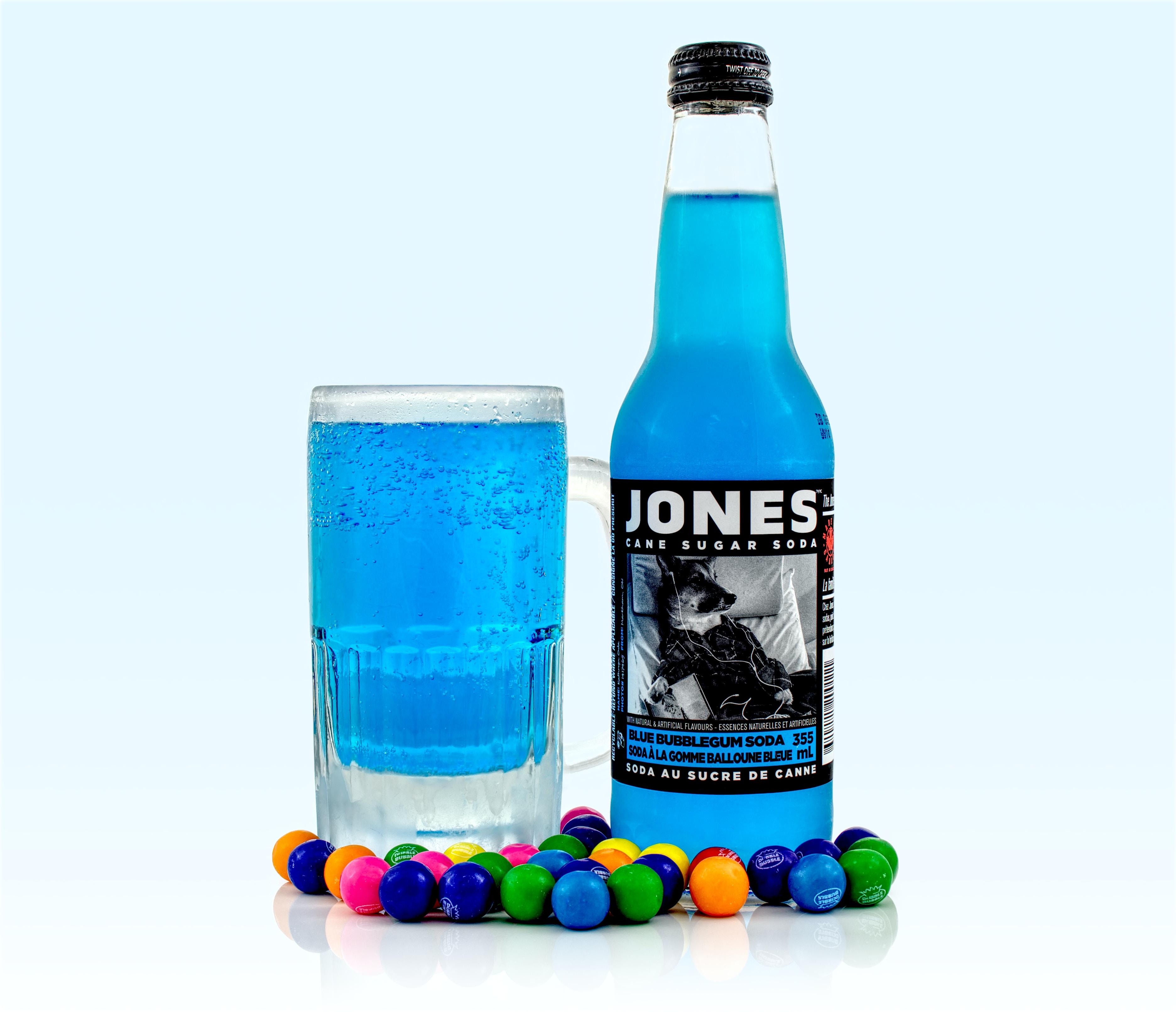 Jones liquor bottle beside glass
