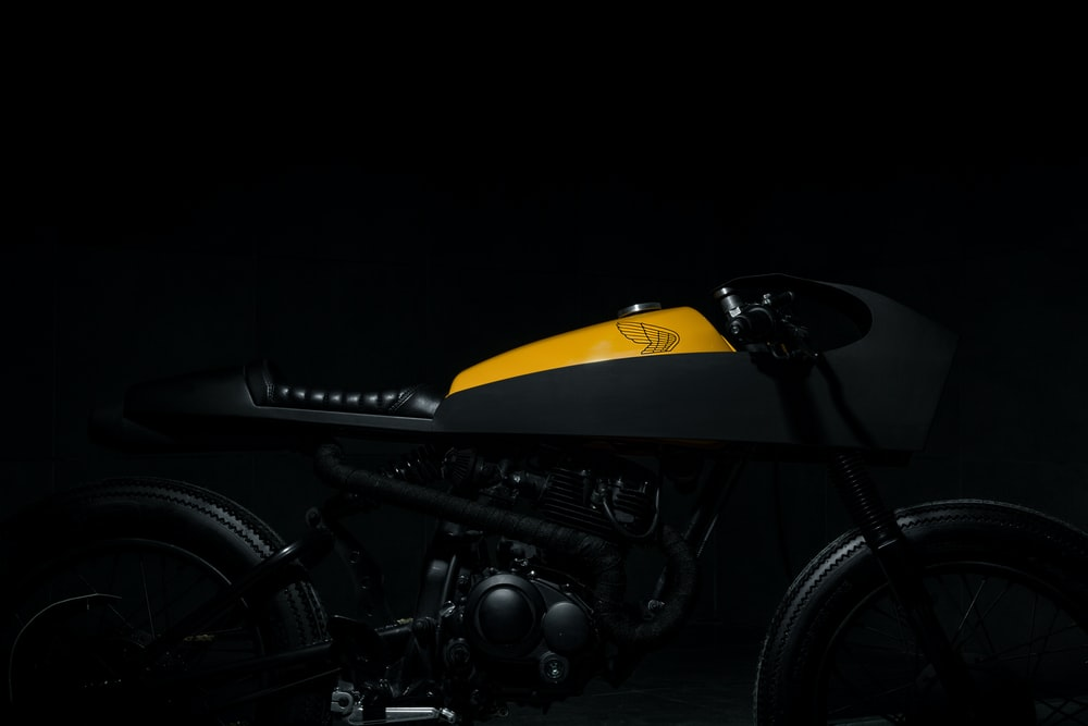 black and yellow motorcycle on isolated black background