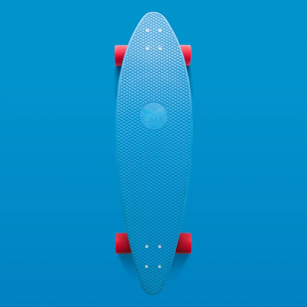 blue and orange longboard