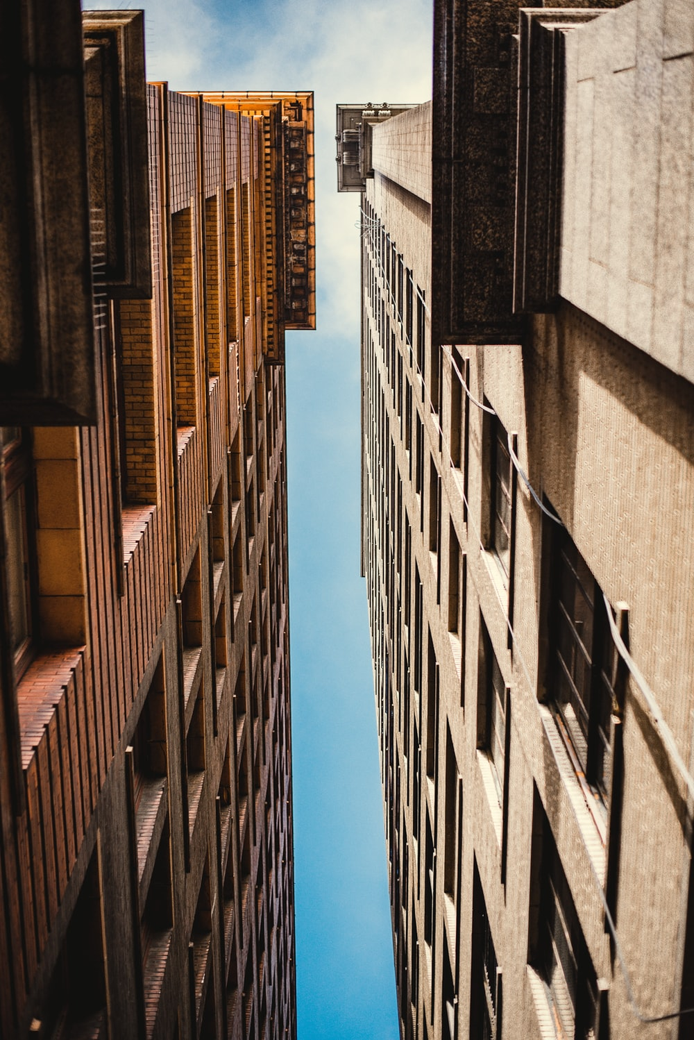 low angle photography of concrete buildings during daytime