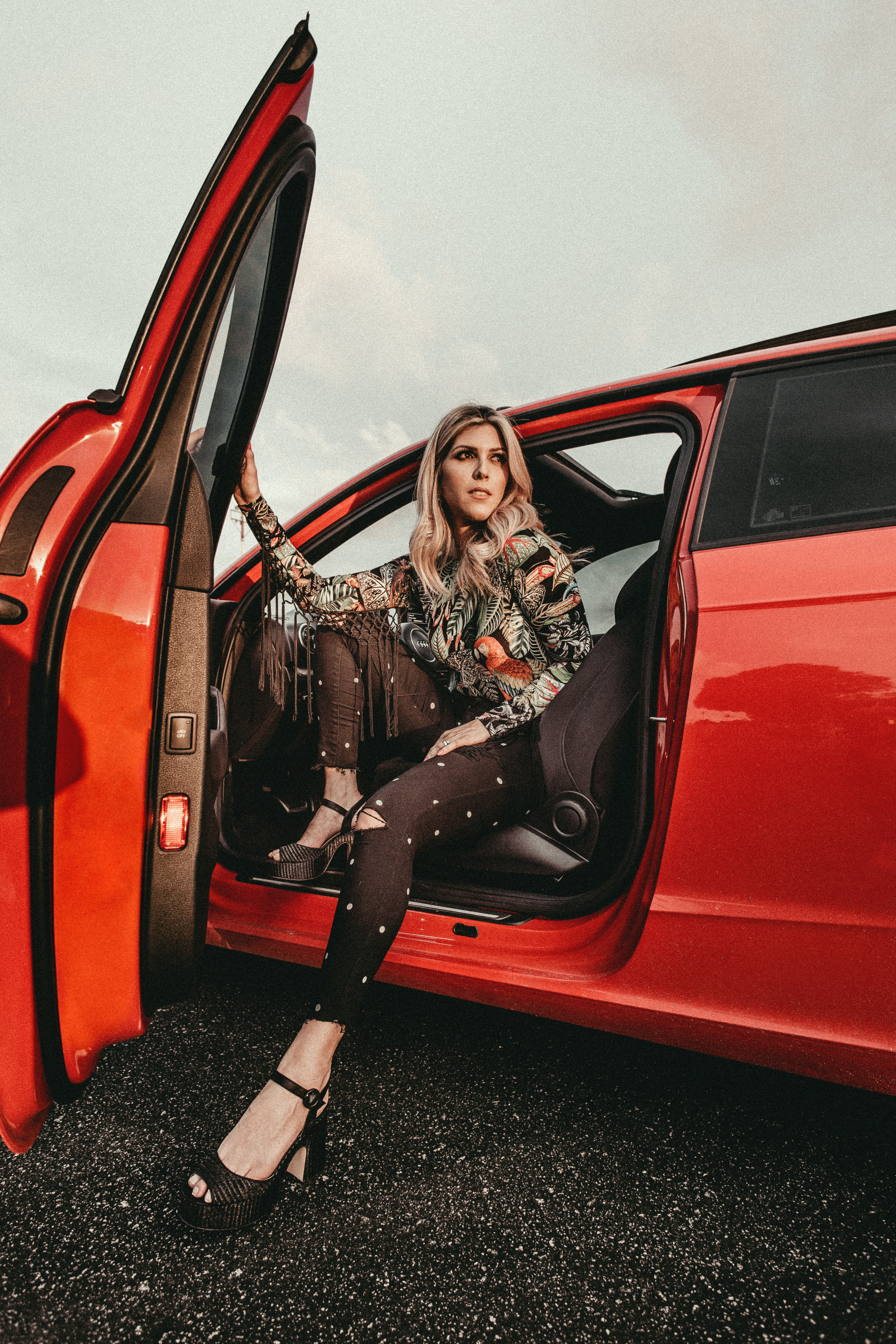 woman in black pants sitting on driver's seat